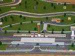 Vista de los boxes, tribuna, torre de marcador, torre de control, aparcamiento y cafeteria.